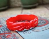 Vintage 1950s red carved plastic bangle
