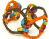 On Sale 25% Off Crochet Bracelet Faux Chainmail Fiber Bracelet Warm Orange Blue Chocolate Brown Golden Yellow Circle Design