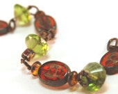 Orange and green Czech glass and natural brass chunky bracelet