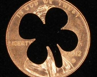 Lucky penny with four leaf clover cut out