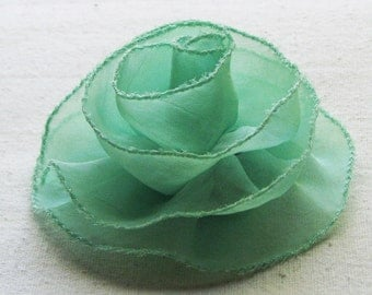 Rose hair clip in airy mint green chiffon, medium-large fabric flower with stitched edge