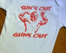 Suns Out, Guns Out.  100 percent cotton. All sizes except adult.