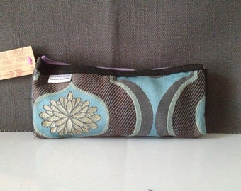 Recycled bike tube and upholstery fabric zippered wallet, clutch, case