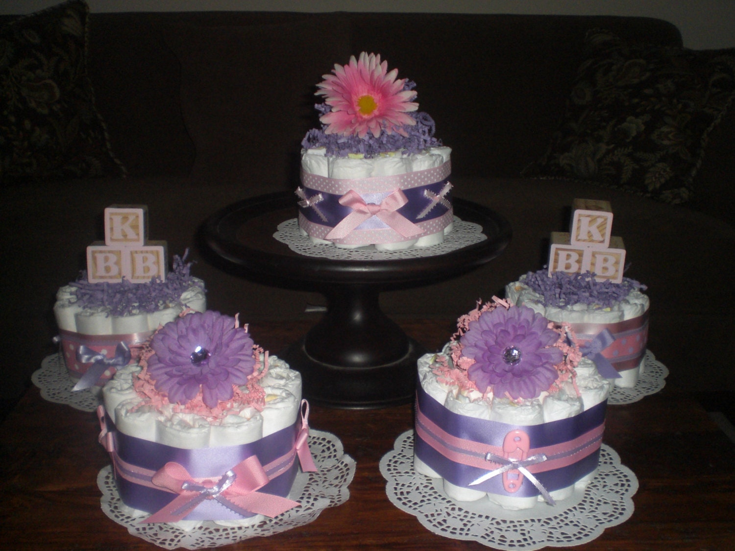 Purple and pink baby shower centerpieces by