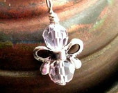 https://www.etsy.com/ie/listing/119477567/pink-butterfly-angel-charm-pendant-or?ref=shop_home_active_9