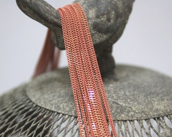 The shiny light pink chain