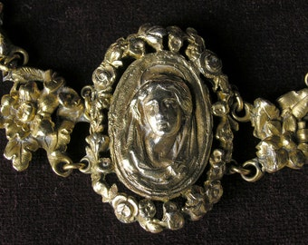 Fabulous religious brass bracelet with a cameo of Mary