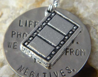 Life is Like Photography We Develop From the Negatives Necklace