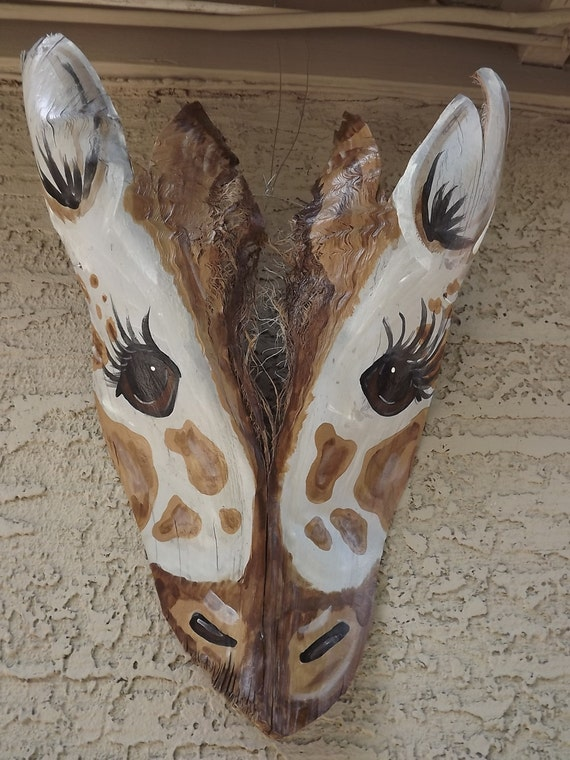 Pictures Of Giraffes Painted On Palm Fronds