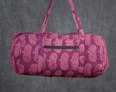 Quilted Duffle bag in Dark Fuchsia with Light Pink Print.