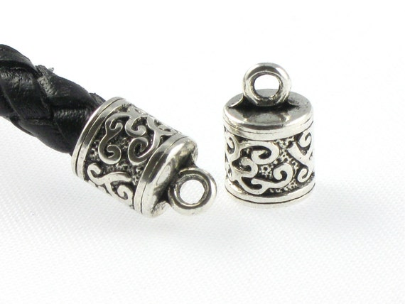 Silver ornate jewelry end caps for leather cord by