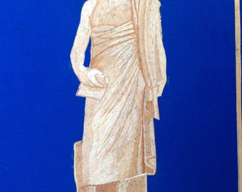 Greek statue in rice straw art. Handmade with dried leaves of rice plant