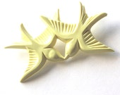 Light yellow resin love birds flying and kissing brooch