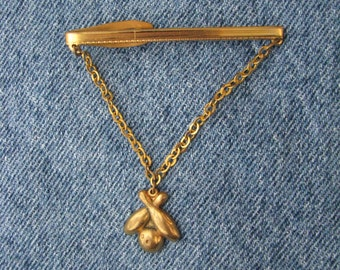 Gleaming gold tone vintage Hickok USA tie clip with bowling pins & ball