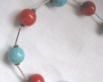 Bright big bead necklace with turquoise blue & brick red beads and silver tone spacers