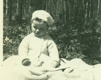 Adorable Baby In Cap and Coat Sitting on a Blanket Outside 1920s Vintage Black and White Vintage Photo Photograph