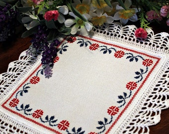 Red and blue cross stitched doily