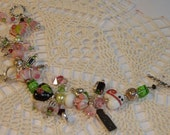 Bracelet.  Pinks, Green, Black, White and Silver.  CLEO