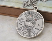 UNTIL 2060 steel working perpetual calendar necklace in silver