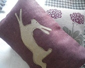 hand printed muted mulberry leaping  hare cushion cover