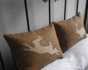 hand printed hare pair cushions
