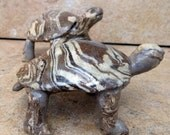 2 Small Brown and White Clay Turtles