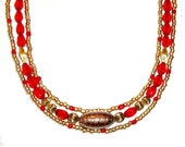 EGYPTIAN INSPIRED triple strand necklace, 19 1/2 inch, red,bronze and gold with Murano Venetian glass center