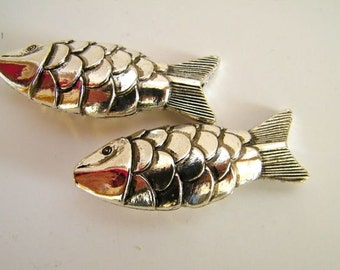 two silvery fish - 64 mm x 22 mm