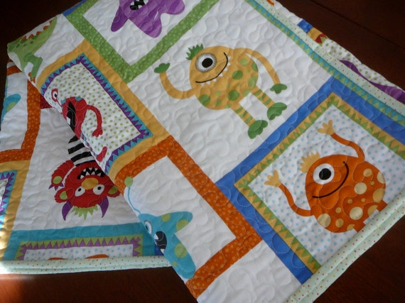 Reserved for amber monster baby quilt in bright primary by for Baby monster fabric