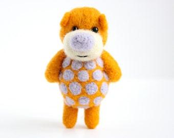 Felted orange pocket bear with pastel violet polka dots