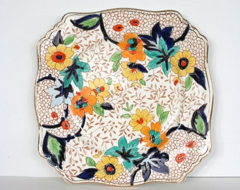 Royal Winton salad plate with ornate Asian inspired motif. Floral, blossoms, blue, orange, yellow, turquoise, fine, scalloped, square.