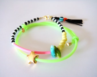 Black and White Beaded Bracelet with Tassel and Neon Pink Rubber Bar, Friendship Striped Bracelet