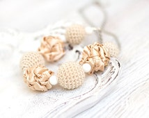 Sand necklace with crocheted and fabric beads