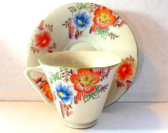 SALE Vintage Orange and Blue Flower Handpainted Teacup and Saucer