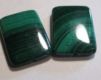 Malachite beads ...              2 pieces ........               25 x 17 x 4.4 mm           .......                a253