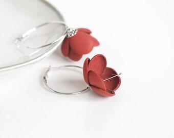 Leather earrings in red orange