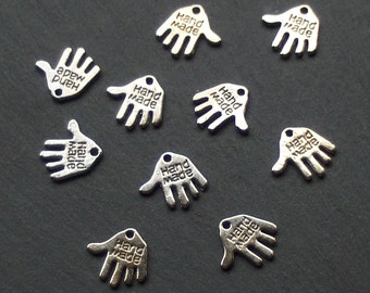 CLEARANCE sale HAND Charms x 10, tibetan silver style, with the word HANDMADE, black tone, reduced was 1 pound, now 80p while stocks last