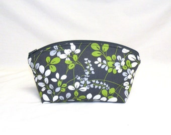 Extra Large Make-Up Bag in botanical leaf pattern in kelly green, cream, and dove grey on dark grey back ground