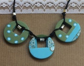 Elegant circles necklace in olive and turquoise, polymer clay with silver tube beads