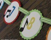 Music Note Just Born/0-12 mos Banner with attached clips to hang 4x6 pictures. First Birthday Photo Banner. Shake, Rattle & Roll. Musical.