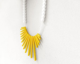 geometric asymmetrical tribal necklace with yellow sticks and white beads - contemporary jewelry