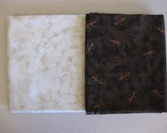 Brown and cream batik-style fabric with ants