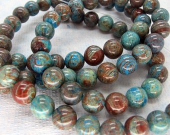 Natural Blue Sky Jasper Smooth Round Beads 10mm - 16 Inch Strand