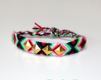 Studded neon friendship bracelet - gold pyramids