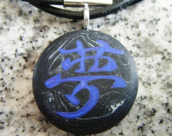 DREAM Japanese kanji symbol hand carved on a polymer clay black marble color background. Pendant comes with a FREE necklace