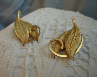 Brushed Gold Tone Leaves with a Swirl Clip on Vintage Earrings