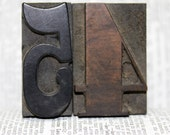 Antique letterpress number 4 and 5 - the collection measures 1 and 7/8 inches by 1 and 3/4 inches - wood