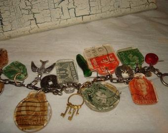 Junk Drawer Bracelet..vintage stamps, found charms, vintage charms