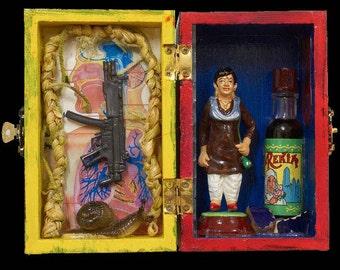 Machine gun snail potion, Hand-made icon box with found treasures.