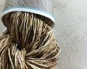 Handspun organic Eri and Tassar silk yarn. 85g. Unusual yarn. Peace silk. Wild silk. Natural handmade silk yarn.